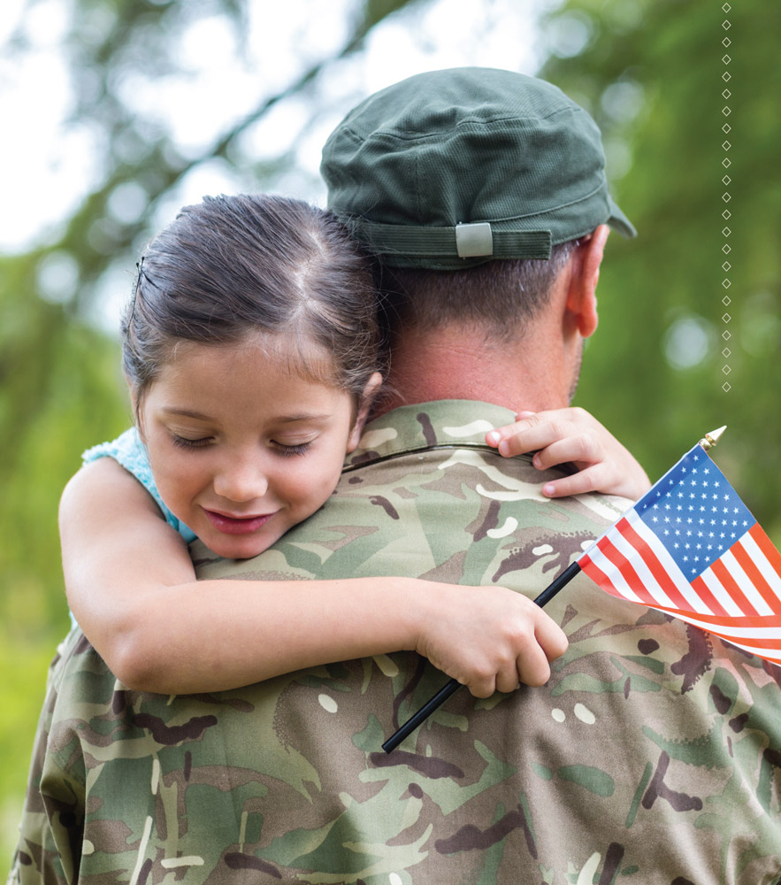 picture of little girl hugging a soldier